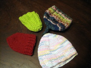 four knit baby hats