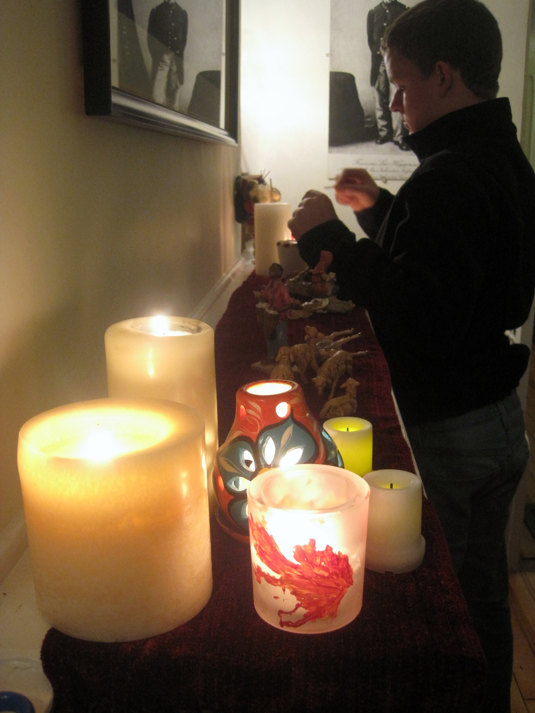 Preparing mantel for Christmas nativity scene