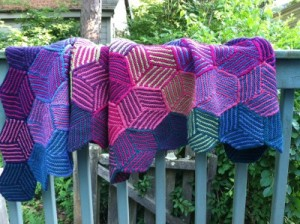 Finished Illusion Cube Blanket over porch railing