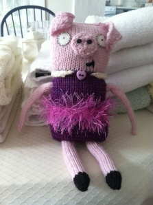 knitted stuffed pig with tutu