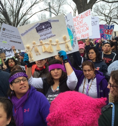 "Haudenosaunee women hold signs ""Original First Ladies"" at Women's March"