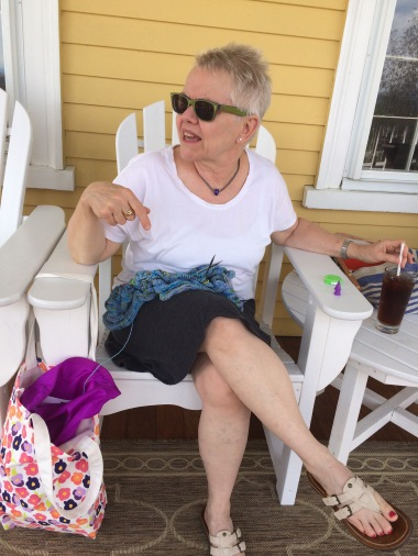 Woman knitting on porch