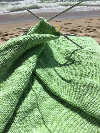 Green Sunshine Coast sweater knitting at beach