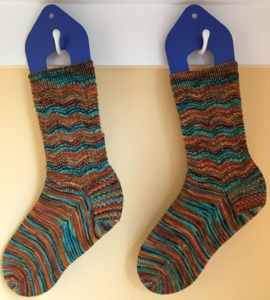 two knit socks hanging to dry