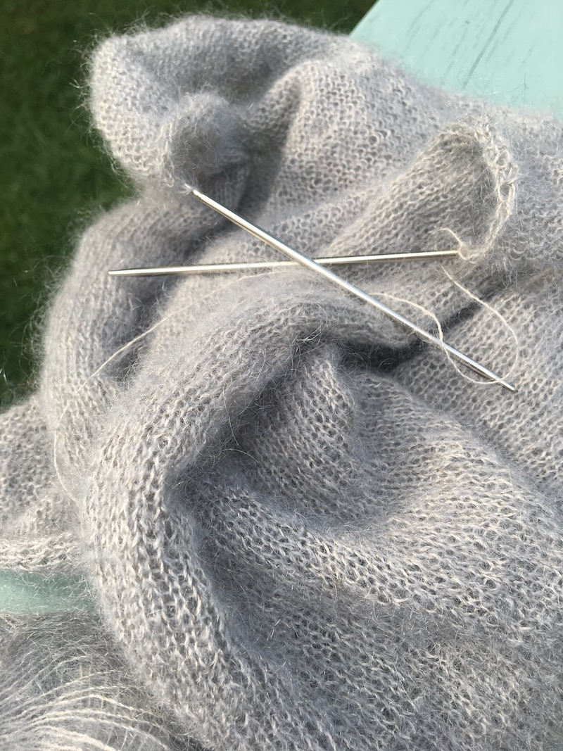 close up of knitting with fine grey yarn